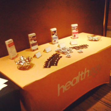Healthegy Branded Table Skirt with Conference Rack-Cards & other Branded Materials